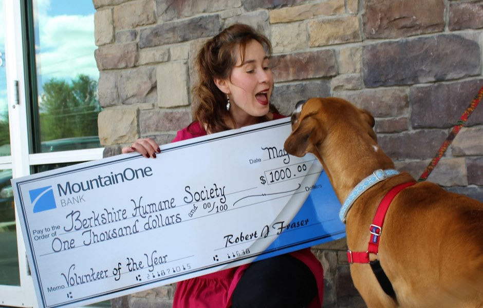 Paula Malloy with donation check