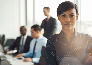 woman standing in front of conference table meeting