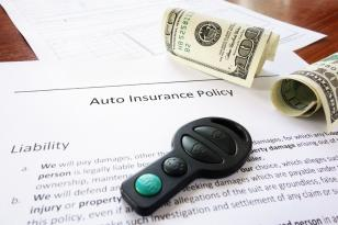 auto insurance policy with key fob and money